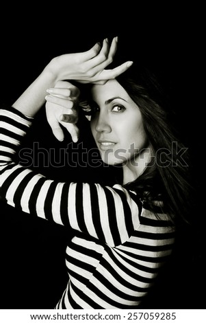 Portrait of young beautiful woman in studio - stock photo