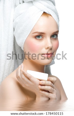 Portrait of young beautiful woman in water holding soap on her palm. Isolated on white background - stock photo