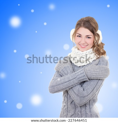 portrait of young beautiful woman in winter clothes over snow christmas background - stock photo