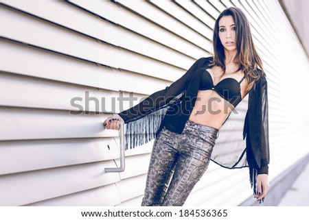 Portrait of young beautiful woman, model of fashion, wearing transparent shirt and black bra - stock photo