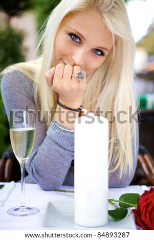 Portrait of young beautiful woman on date at a restaurant. - stock photo