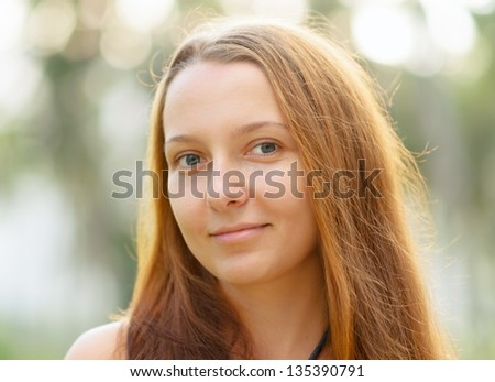 Portrait of young beautiful woman outdoors. - stock photo