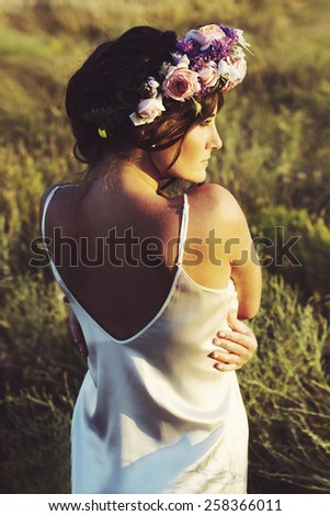 Portrait of young beautiful woman outdoors - stock photo