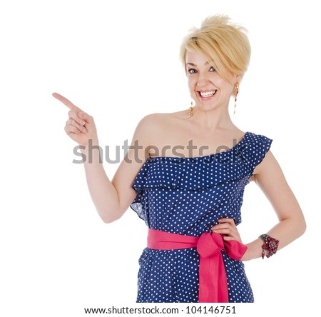 Portrait of young beautiful woman pointing at white background. isolated - stock photo