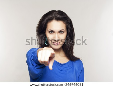 Portrait of young beautiful woman pointing at you - stock photo
