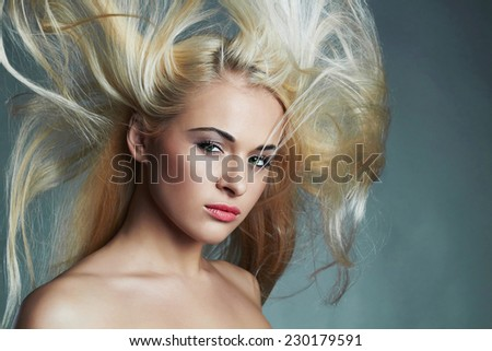 portrait of young beautiful woman. Sexy blond girl. Beauty salon.Haircare.Flying hair - stock photo