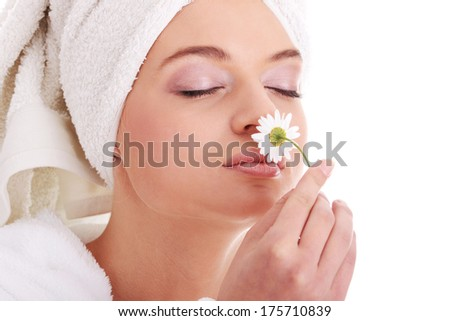 Portrait of young beautiful woman wearing bathrobe, isolated on white  - stock photo