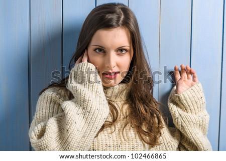 Portrait of young beautiful woman wearing winter beige sweater - stock photo