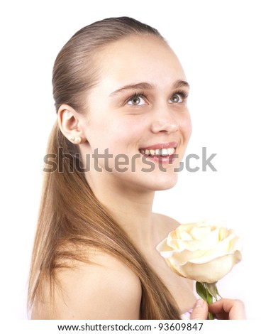portrait of young beautiful woman with a flower isolated on a white background - stock photo
