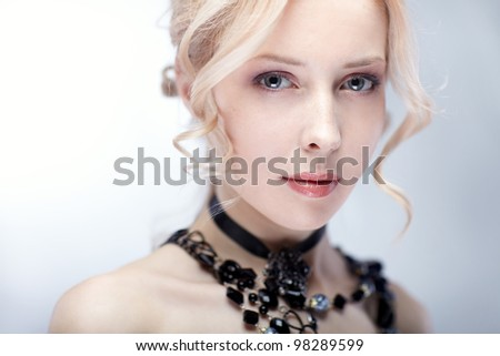 Portrait of young beautiful woman with blond hair - stock photo