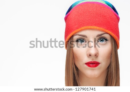 Portrait of young beautiful woman with blue eyes, red lips and red hat on a white background - stock photo