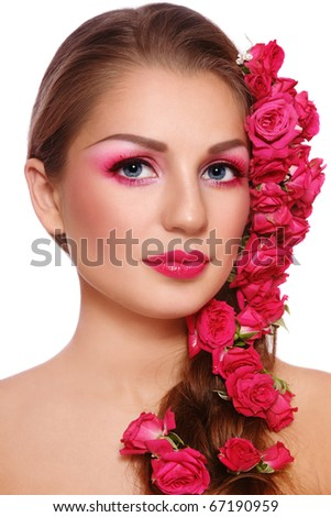 Portrait of young beautiful woman with bright make-up and roses in hair, on white background - stock photo