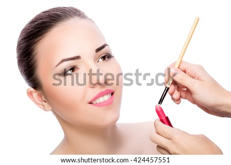 portrait of young beautiful woman with brown eyes isolated on a white background. high key.  everyday makeup  - stock photo