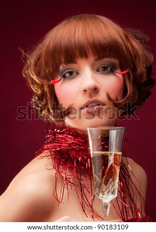 Portrait of young beautiful woman with champagne glass