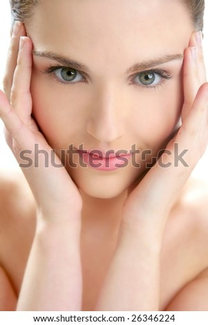 Portrait of young beautiful woman with clean skin at studio - stock photo