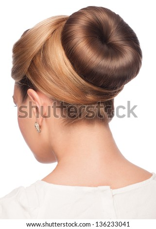 Portrait of young beautiful woman with creative elegant hairstyle, hair bun. Isolated on white background