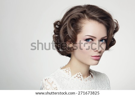 Portrait of young beautiful woman with curly prom hairdo in vintage style - stock photo