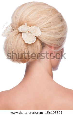 Portrait of young beautiful woman with elegant hairstyle, over white background. Rear view - stock photo