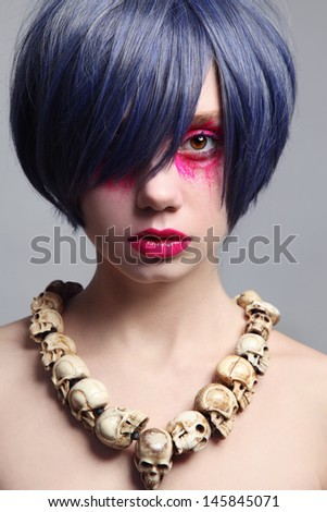 Portrait of young beautiful woman with fancy bright make-up and cosplay wig - stock photo