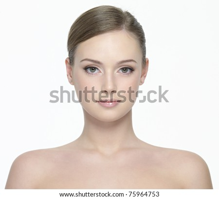 Portrait of young beautiful woman with fresh clean skin - isolated on white background - stock photo