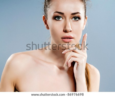 Portrait of young beautiful woman with fresh clean skin with cream - stock photo