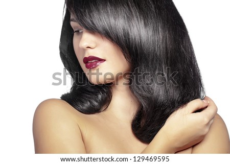 Portrait of young beautiful woman with glossy hair
