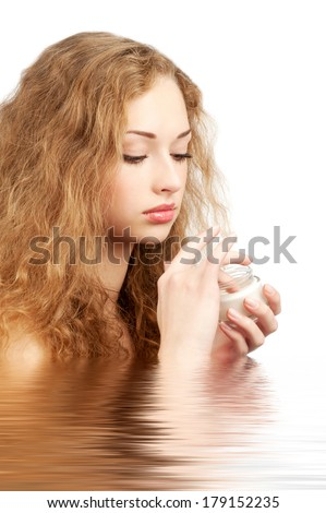 Portrait of young beautiful woman with jar of moisturizing cream in water, isolated on white background - stock photo