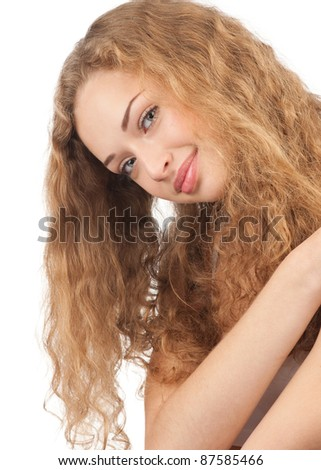 Portrait of young beautiful woman with long blond curly hair hugging yourself, isolated on white background - stock photo