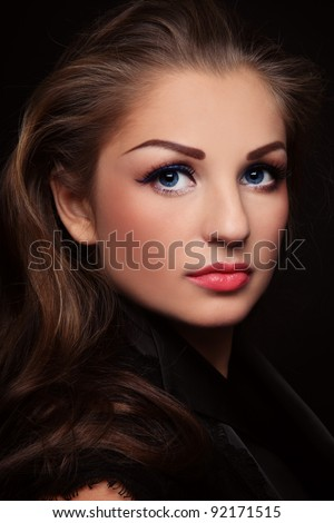 Portrait of young beautiful woman with long curly hair and stylish make-up - stock photo