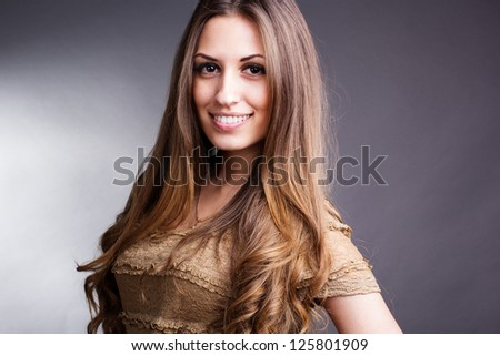 Portrait of young beautiful woman with long  hair - stock photo