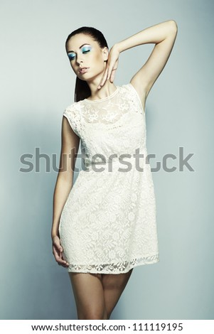 Portrait of young beautiful woman with long magnificent hair. Fashion photo - stock photo