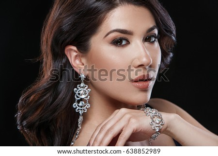 Portrait of young beautiful woman with luxury jewelry
