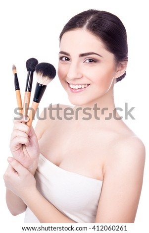 portrait of young beautiful woman with make up brushes isolated on white background - stock photo