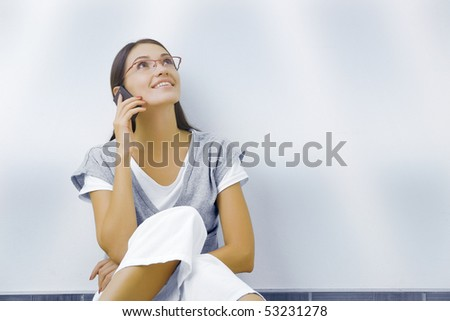Portrait of young beautiful woman with mobile phone