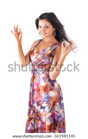 Portrait of young beautiful woman with ok gesture. Isolated over white background - stock photo