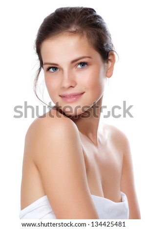 Portrait of young beautiful woman with perfect skin