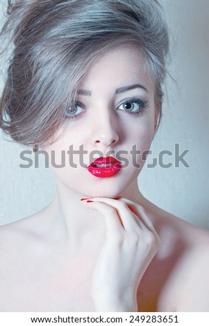portrait of young beautiful woman with red lipstick. filtered in cold tone - stock photo