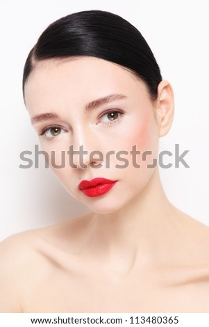 Portrait of young beautiful woman with red lipstick over white wall - stock photo