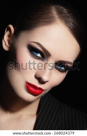 Portrait of young beautiful woman with smoky eyes and red lipstick - stock photo