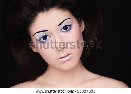 Portrait of young beautiful woman with sparkly futuristic make-up - stock photo