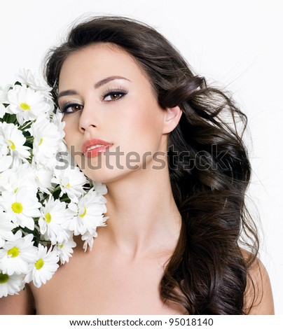 Portrait of young beautiful woman with spring flowers - white background