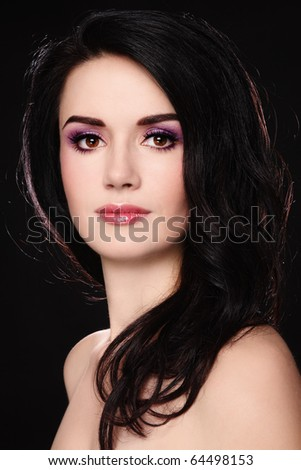 Portrait of young beautiful woman with stylish make-up on dark background - stock photo