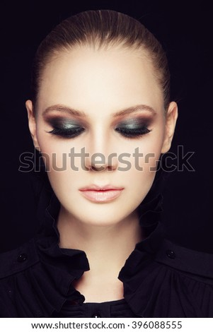 Portrait of young beautiful woman with stylish sexy smoky eyes make-up - stock photo