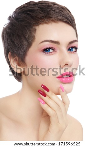 Portrait of young beautiful woman with stylish short hair cut, pink make-up and fancy manicure over white background - stock photo