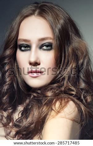 Portrait of young beautiful woman with stylish smokey eyes  - stock photo
