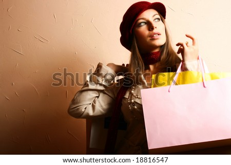 Portrait of young beautiful women with her shopping bags - stock photo