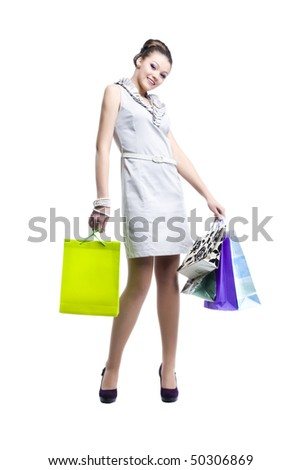 Portrait of young beautiful women with her shopping bags. Isolated on white background - stock photo