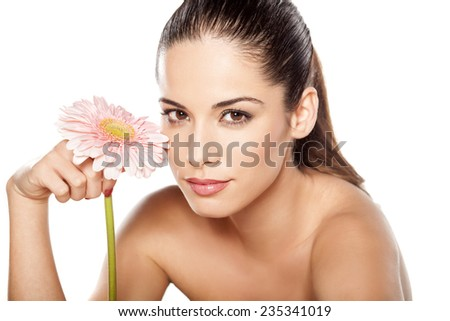 Portrait of young beautiful young woman with gerbera