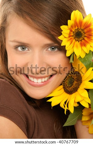 Portrait of young beauty happy woman with sunflowers