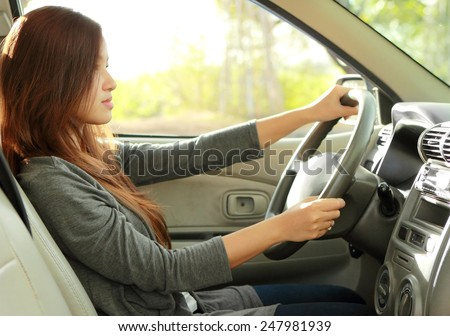 portrait of young beauty woman driving a car - stock photo